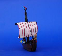 Hoist the Sail! (Robert4168/Garmadon) Tags: lego viking micro ship longship ristovic sail white red shields figurehead dark brown flag blue