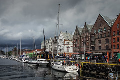 The charm of a rainy day (Fr@nk ) Tags: dsc09404defbergen bergen norway norge travel holiday rain weather beauty enchanting europe sonya7r canonef1635mmis bryggen sailboat harbour shore sea ocean girls women people street chicks chicas topf25 topf50 topf75 topf100 topf150 krumpaaf mrtungsten62 interesting interestingness frnk