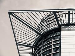 Corner Of A Round Building (amarilloladi) Tags: 7dwf floors stories highrise architecture monochrome blackandwhite bw square round geometric berlin buildings