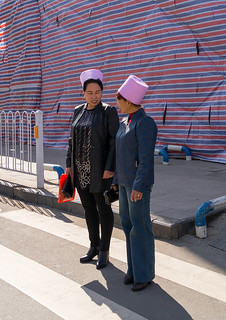 Muslim women with the traditional pink hats in the street, Gansu province, Linxia, China