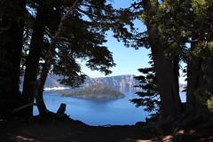 Wizard Island (Jane Inman Stormer) Tags: trees silhouette island park craterlakenationalpark blue water volcano cliffs wizardisland oregon lake landscape