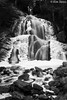 Moss Glen Falls - Stowe, Vermont (Kim Toews Photography) Tags: stream longexposure icicle nature landscape rocks forest trees usa monochrome ice icy water bw blackandwhite seasons falls waterfall vermont stowe mossglenfalls