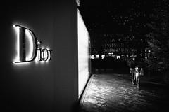 Christmas shopping (ThorstenKoch) Tags: street streetphotography stadt strasse schatten shadow schwarzweiss christmas christmaslights dior düsseldorf duesseldorf königasallee licht lights linien lines light fuji fujifilm thorstenkoch city candit shopping bike blackwhite outdoor