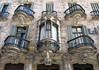 The central oriel and balconies, Casa Calvet (1899) by Antoni Gaudí, Barcelona (Spencer Means) Tags: house casacalvet antonigaudí dreta eixample barcelona catalonia catalunya spain modernista modernisme window oriel bay balcony balkon balcón wroughtiron ironwork facade façade
