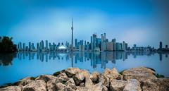 Toronto Skyline (ADW44) Tags: toronto canada ontatio reflection leebigstopper ndfilter skyline cntower skyscrapers water rocks longexposure