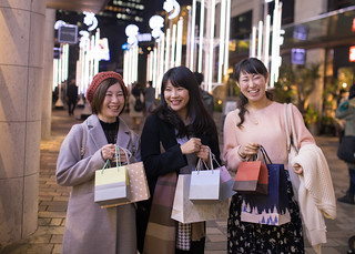Young women shopping together at Christmas night