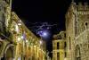 Luna en Taormina (MigueR) Tags: italia sicilia taormina sicily urbana calle luna nocturna nubes banderas fuji xt1 cielo noche edificio