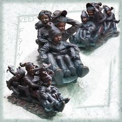 Keep Flyin' ! (Koko Nut, it's all about the frame) Tags: keepflyin sculpture bronze bronzesculpture sledding cold snow children 5 square framed montrealchildrenshospital koko kokonut wonder