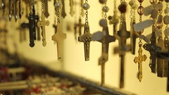 Faith (halifaxlight) Tags: italy vatican romancatholic religiousitems souvenirs rosaries crucifixes shop display bokeh