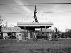 (el zopilote) Tags: bagdad california mojavedesert architecture street townscape smalltowns signs powerlines clouds us66 lumix gf1 milc m43 lumixg20mmf17asph bw bn nb blancoynegro blackwhite noiretblanc digitalbw bndigital schwarzweiss monochrome