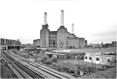 Another Break in the Wall (Steve Lundqvist) Tags: power electric electricity station energy london londra england inghilterra uk kingdom railway train urban city town urbanlandscape street railroad road streetphotography color vintage pink floyd animal pig pigs battersea view nikon 24mm cimney ciminiera camino inquinamento pollution ambiente energia elettrico elettricità environmental open abandoned factory fabbrica decay brik wall work worker dust smoke fumo polvere compo composition reflection mood allaperto