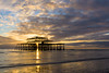 Sunset at the West Pier (hehaden) Tags: architecture structure ruin pier westpier sea sky clouds sunset sunburst starburst reflection evening brighton sussex sel24f18z