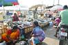 Fish market (Francisco Anzola) Tags: ngc chennai madras india tamilnadu asia marinabeach women fishmongers fish umbrellas motorcycle