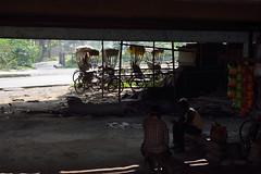 Parked (sanat_das) Tags: kolkata baghajatin morning undertheflyover parked rickshaws mensitting d800 28300mm