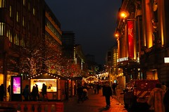 Manchester Christmas market(GB) (alex.vangroningen) Tags: manchestergb royalexchangetheather people chalets buildings trees lights bluehour windows handheld