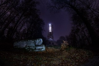 mystical tower in the middle of the forest