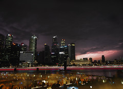 Looming Storm (elenaleong) Tags: mbs thunderandlightning stormclouds nightscape waterfront crowd skyline elenaleong