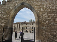 Gateway into the Abbey Grounnds, Burgos (d.kevan) Tags: spain burgos abbeys historicbuildings gates courtyards lashuelgas arches people walls stonework 1187 plants trees