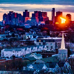 Sunset reflecting off downtown Boston ((Jessica)) Tags: boston downtown sunset telephoto skyline sony somerville newengland 55210mm massachusetts reflection compression