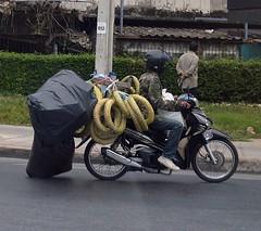 bouncing along on the roadway (the foreign photographer - ฝรั่งถ่) Tags: man motorcycle black plastic bags laksi traffic circle bangkhen bangkok thailand nikon d3200