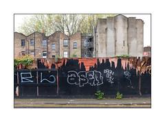 Demolition Site, East London, England. (Joseph O'Malley64) Tags: demolition hordings woodenfencepanels victorianhouses victorianbuildings victorianstructures eastlondon eastend london england uk britain british greatbritain change gentrification highdensityhousing londonplanetrees weeds ivy brickwork bricksmortar cement pointing sashwindows drainpipes chimneypots scaffold scaffolding sign signage graffiti tags concrete granitekerbing tarmac doubleyellowlines noparkingatanytime parkingrestrictions urban urbanlandscape fujix x100t accuracyprecision render wallwashers