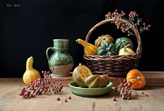 Autumnal Tints (Esther Spektor - Thanks for 12+millions views..) Tags: stilllife naturemorte bodegon naturezamorta stilleben naturamorta composition creativephotography artisticphoto art autumn tabletop pumpkin squash gourd berries basket pitcher bowl slice ceramics wicker wooden ambientlight yellow green orange red brown black estherspektor canon