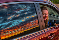 The Girl or the Sunset... (tquist24) Tags: goshen hdr hww indiana nikon nikond5300 outdoor wanda blue car clouds color evening geotagged girl orange photographer portrait pretty reflection reflections sky smile sunset window woman unitedstates