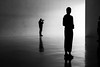 2271 (explored) (.niraw) Tags: kolumbamuseum köln gegenlicht menschen fotograf strasenfotografie dreieck spiegelung bw kunst leer kontrast hell dunkel gruppe silhouette brille brillengläser reflexion
