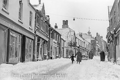 Wotton Long Street (Maintained by Matthew Bigwood) Tags: briancandy wottonunderedge monochrome 35mm film snow 1963 gloucestershire briancandyphotographicarchive