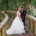 Kiss on a path through the forest - Reserve Harbor Yacht Club thumbnail