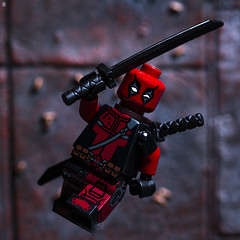 Deadpool Attack (Jezbags) Tags: lego legos toy toys marvel marvelstudios legomarvel macro macrophotography macrodreams macrolego canon60d 60d 100mm closeup upclose deadpool sword jump attack