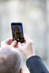 Man taking photos of Cologne Cathedral with his iPhone (marcoverch) Tags: köln cologne 2017 dom kölnerdom nordrheinwestfalen deutschland de man takingphotos colognecathedral iphone people menschen mann woman frau telephone telefon blur verwischen adult erwachsene one ein indoors drinnen business geschäft outdoors drausen hand connection verbindung technology technologie wireless kabellos portable tragbar wear tragen touch berühren looking suchen daylight tageslicht contemporary zeitgenössisch otoño walk lines airplane cold berlin photoshop canal nyc candid