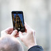 Man taking photos of Cologne Cathedral with his iPhone