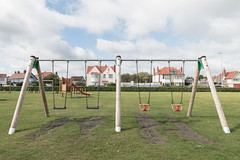 Swingers (Number Johnny 5) Tags: lines objective d750 2470mm slide space empty orange red blue playground mundane swings banal playpark gorleston nikon deserted green angles tamron documenting subjective