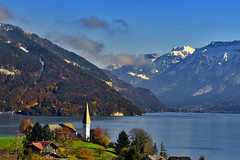 The Thunersee & the Kirche St. Columban , Faulensee at late autumn time.15.11.17, 13:35:25 . Izakigur No. 1026. (Izakigur) Tags: switzerland thunersee lakethun kirche nikkor2470f28 autumn water izakigur pro 1mo nikond810 luz lumière light licht ضوء אור प्रकाश ライト lux światło свет ışık nikon automn trees tree fall herbst automne autunno outono 秋 पतझड़ خريف پاییز סתיו svizzera lasuisse lepetitprince thelittleprince ilpiccoloprincipe helvetia liberty flickr feel europe europa dieschweiz ch musictomyeyes nikkor suiza suisse suisia schweiz suizo swiss سويسرا laventuresuisse myswitzerland landscape alps alpes alpen schwyz suïssa