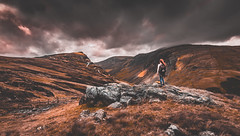 Wilderness (Toukensmash) Tags: wild wilderness england lake district uk united kingdom sony alpha58 sigma1020 wide angle adventure processing dark moody brown sky stormy english mountains landscape person woman one colour editing outdoors journey interrail road peak walking hiking buttermere honister pass