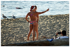 Me, taking a photo of him, taking a photo of her, taking a photo of them (HereInVancouver) Tags: candid beach ocean water pacific englishbay log photographer selfie twowomen outdoors city urban vancouverswestend thingstodobythewater vancouver bc canada canong3x seagulls