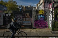 Stokes Croft Scenes (zolaczakl) Tags: october bristol nikond7100 stokescroftscenes cyclist posters streetart graffiti photographybyjeremyfennell urban sigma1835mmf18dchsmlens uk wall streetscenes bicycle pavement figure people 2017