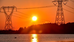 The highest power (Christie : Colour & Light Collection) Tags: sunset bright brighness solar electrical energy reflections sun silhouette highvoltage powerlines tower wires evening sundown vibrant vibrance intenselight light