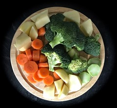 0552 Chopped vegetables. (Andy - Tak'n a breever) Tags: bbb broccoli carrots ccc choppedvegetables choppingboard ggg greens ooo orange photostream potato ppp squareformat white wood www xxx xyloid