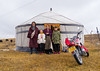 Portrait of a tibetan nomad family living in a yurt in the grasslands, Qinghai province, Sogzong, China (Eric Lafforgue) Tags: adventure asia asian children china china17640 colourimage cultures family fourpeople fulllenght grassland grazing henan highaltitude horizontal journey land lookingatcamera men motorcycle nomadic nonurban portrait qinghaiprovince residential rural sogzong structure tent tibet tibetan traditional travel women worldtravel yurt chn
