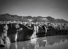 At the Toe of the Sleeping Giant (Never Exceed Speed) Tags: reflection water snow ice aerialphotography landscape blackandwhite alaska glacier scenery