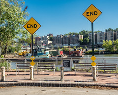 Sherman Creek Park at West 206th Street, Inwood, New York City (jag9889) Tags: workboat shermancreek usa building signpost waterway deadend inwood newyork outdoor 20171019 barge uppermanhattan 2017 road tree tugboat bench newyorkcity nycparks sky harlemriver sign jag9889 manhattan fence barrier railing w206street