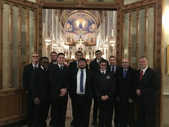 Seminarians gather before Mass at the entrance to Rosary Cathedral in Toledo, OH, on Sunday, November 19, 2017