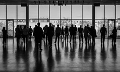 Reflected Crowd (tim.perdue) Tags: columbus museum art cma cmoa mycma ohio gallery black white bw monochrome shadow reflection crowd reflected group people street candid window floor silhouette