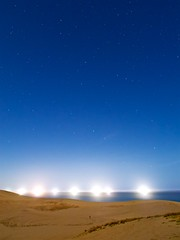 Alone on the Planet (somazeon) Tags: japan m43 lumix panasonic 日本 鳥取 tottori 漁火 fishing boat sand dunes night nightshot