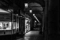 coming from the dark / follow the leading light (Özgür Gürgey) Tags: 2017 50mm bw colonnaden d750 darkcity hamburg nikon architecture lowlight people repetition shades street