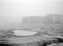 One foggy morning before work. (wojszyca) Tags: fuji fujica gsw680iii 6x8 mediumformat fujinon sw 65mm gossen lunaprosbc ilford hp5 hc110 163 epson v800 fog gasstation truck parking lot puddle mud morning nostalgia