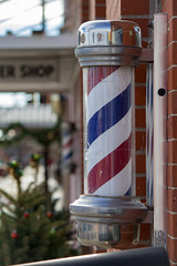 Barber Shop (Tammy Strot) Tags: sign barberpoll barbershop poll wall building canon canonusa outdoor bokeh outdoorsign