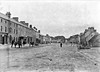 Meet Moate's Main Street - from the west! (National Library of Ireland on The Commons) Tags: eason easonson easoncollection easonphotographiccollection glassnegative 20thcentury nationallibraryofireland moate cowestmeath ireland mainstreet west horses donkeys carts houses chimneypots well countywestmeath pump villagepump cart mart blackburn morganolmotoroil carburinemotorspirit kelly morganollubricants